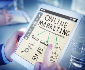Online marketing plan on tablet stating SEO Glasgow as first step.